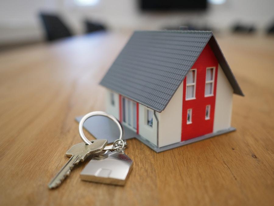 Buy a home figure with keys